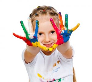 child showing hands full of paint