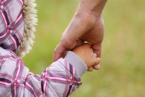 child holding hands with father